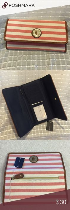 "Tommy Hilfiger coral/cream stripe tri fold wallet Super cute coral/cream canvas exterior & navy interior. Brown ""leather"" trim adds richness to this hold all my stuff wallet! Tommy Hilfiger Accessories"