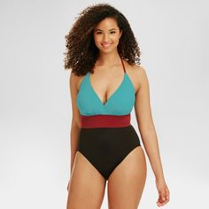 Nothing can block your way in this Slimming Control Colorblock One Piece from Beach Betty. In stormy blue and burgundy, paired with classic black, this figure-flattering style is sure to be your new fave. Clever seaming whittles your waistline and shows off your shape, while a plunge neckline draws the eye in all the right directions. An adjustable halter tie and removable foam cups offer a customizable fit and keep you supported. Miracle Brands™ exclusive fabric slims your silhouett...