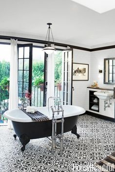 White and black tiles and tub