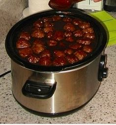 1 bottle of sweet baby rays BBQ sauce, a jar of grape jelly, and meatballs of your choice in a crockpot for 6 hours = a delicious appetizer or party starter