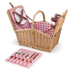 "The Piccadilly Picnic Basket is reminiscent of simpler times, when picnics were grand affairs and life's pace afforded you the time to enjoy them to the fullest. This fully-lined red and white plaid willow basket measures 16"" long and has a easy-access double-lid design with service for two. Included are 2 plates (PS, 8"", solid white), 2 wine glasses (PS, 8 oz.), 2 (18/0) stainless steel forks, knives, and spoons (plastic, wood grain design handles), and 1 stainless steel waiter-style…"