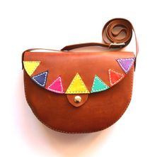 A croquer ! Le petit sac en cuir aux accents latino-américains ! Fait-main, on adore sur DaWanda.com