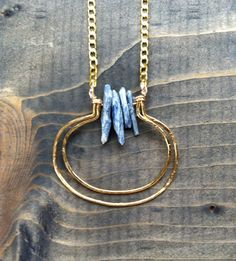 Raw kyanite and hammered wire crescent necklace / moonlight / bluetribe etsy shop by bluetribe. Explore more products on http://bluetribe.etsy.com