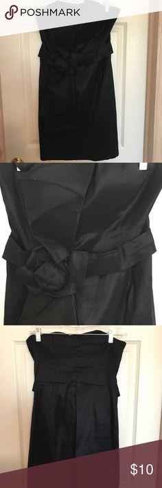 Little black dress Super cute black dress. Huge bow in front that runs the length of the dress. Dresses