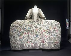 'Court dress' was an exclusive and very ornate style of clothing worn by the aristocracy, the only people usually invited to attend at Court. The style of the robe is quite old-fashioned, and based on the 17th-century mantua.