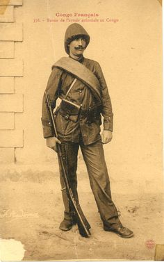 Translated caption reads: ''French Congo. Colonial army uniform in Congo''. Congo Français. Photograph by J. Audema. ca.1905