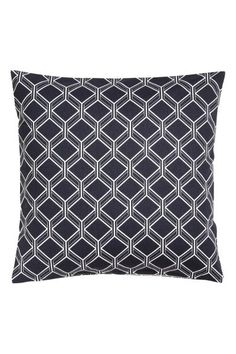 Wzorzysta poszewka na poduszkę: Poszewka na poduszkę z bawełnianego diagonalu we wzorzyste nadruki. Kryty suwak.
