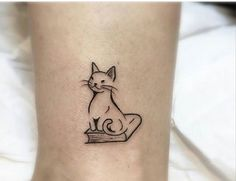Cat and book tattoo