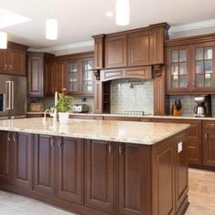 Timothy Lombardozzi of Just In Cabinets and Interiors designed this show-stopping kitchen using 760 Cherry Spice for his entry in our Showcase Your Space contest—so elegant.  #waypointlivingspaces #kitchencabinets #evolvedelegance #cherryspice Maple Cabinets, Cherry Cabinets, Kitchen Doors, Kitchen Cabinets, Kitchen Facelift, Mountain House Plans, Cabin Kitchens, Cabinet Doors, Kitchen Inspiration