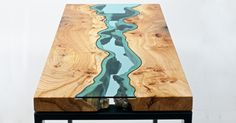 Furniture maker Greg Klassen builds intricately designed tables and other objects embedded with glass rivers and lakes. Inspired by his surroundings in the Pacific Northwest, Klassen works with edge pieces from discarded trees (often acquired from construction sites, or from dying trees that have be