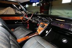 what a fantastic Buick Riviera interior… the wood is really set off against the black upholstery