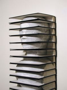 """Tab, 2005, Altered Set of Vintage Encyclopedias, 51""""(h) x 10.25""""(w) x 7.5""""(d) - Image Courtesy of the Artist"""