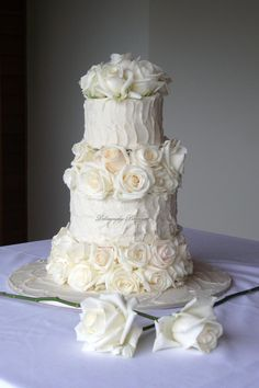 White Buttercream Wedding Cake with Roses or even better.... roses from Burlap~  Easy and imaginative.... add a slice of tree wood base=)