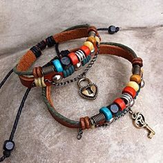 These bracelets has been made by PixSun. The details include: Cow leather ropes with an adjustable fastening. Decorate with wooden beads and ally charms. 19 cm ~27 cm adjustable approx. length  ____________________  Coming soon! We will ship this couple bracelet on 25th Feb.