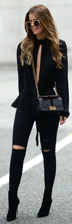Anette Haga is looking fierce in this all black outfit of black jeans and an open-slit tee! Top: H&M, Bag: Chanel, Jeans: Topshop, Shoes: Christian Louboutin