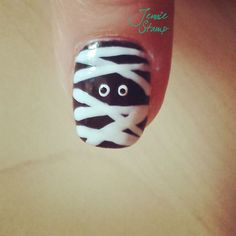 McKenna... check these out. Spooky Halloween Nail Art