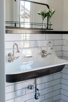 Custom double bathroom with cast iron trough sink - by Rafterhouse, contemporary style, white subway tiles