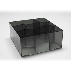 Alice Coffee Table Series of parallelepiped shaped low tables in mm. 6 tempered smoked glass, glued 45°, to whose inside contains a complex honeycomb structure. Four little chromiumplated feet slightl