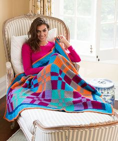 Although it was inspired by a traditional fabric quilt design, this crocheted throw has a decidedly modern outlook. Use the same seven colors shown, or change it up for your own unique take on this cozy throw.