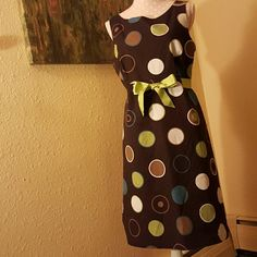 Polkadot Dress T-length polkadot dress with green ribbon belt. Zipper cloaure in back. Ribbon can be tied to accent waistline. Perfect for Easter, wedding, church, or spring! Willow Glenn New York Dresses Asymmetrical