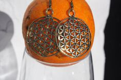 Golden brass ancient flower of life sympol by AUROBELLE on Etsy, €18.00
