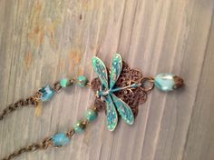 Brass Dragonfly on filigree necklace. Green patina.