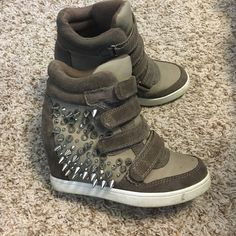 Spiked sneaker wedges Tan with silver spikes on the sides .. Velcro to open & close ALDO Shoes Wedges