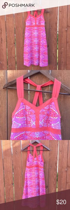 Dakini athletic style strappy paisley dress S Pink and white and coral dress with cool strappy back. Athletic style but no shelf bra. Could easily be dressed up as well. Excellent used condition. Approximate flat measurements: chest 14.5in, waistband 14in, length 36in. Dakini Dresses