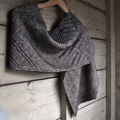 Architexture is a rectangular scarf with pointed ends. Fully reversible, it is a collection of textures that enhance one another ~ made all the more striking because they are knitted on the bias. The frequent changes in stitch pattern keep the project engaging from beginning to end.