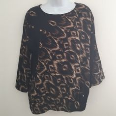 "Chico's 3/4 Sleeve Animal Print Blouse Size 0 Chico's 3/4 Sleeve Black & Brown Animal Print Blouse Size 0  NWOT Bust 40"" Length 25"" Elastic Waistband 1 1/2"" Chico's Tops Blouses"