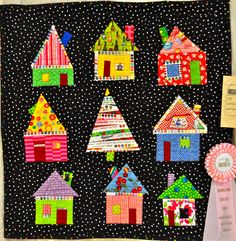 Bright House Quilt -  I love the use of selvages, no surprise that this quilt won a ribbon.