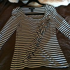 WHBM black and white top 3/4 length sleeves White House Black Market 3/4 length sleeve top. 91% rayon, 6% spandex and 3% other fiber.  Black and white striped with subtle silver metallic. Gently used a few times, but still in great condition. Beautiful top. Pictures don't do it justice. White House Black Market Tops Blouses