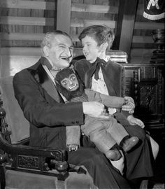 American actor and political activist Al Lewis (as Grandpa) sits and holds child actor Butch Patrick (as Eddie Munster) and a wolfman doll in his lap on the set of the CBS television situation comedy 'The Munsters' episode 'My Fair Munster,' April Munsters Tv Show, The Munsters, 1313 Mockingbird Lane, Black Sheep Of The Family, Yvonne De Carlo, Female Vampire, Classic Monsters, Child Actors, Butches