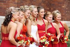 red and orange wedding dresses - bridesmaid dresses - flowers - bouquet
