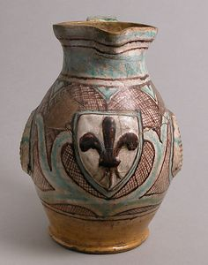 Jug Date: late 14th–early 15th century Geography: Made in probably Orvieto, Umbria, Italy Culture: Italian Medium: Earthenware, tin-glaze (Majolica)