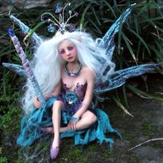 My beautiful OOAK faerie by Celia Anne Harris that is the pride and joy of my collection.