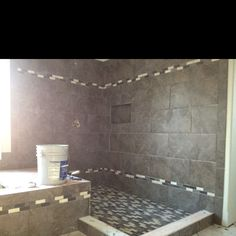 Master-bath... Tile with accent piece.