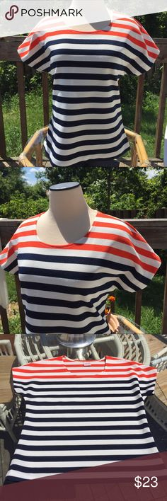 "Awesome vintage 70s striped pull over top S/M Slightly fitted white with navy and orange strips pull over top. 100% polyester, heavier knit, fabric does have stretch, in prefect condition. By Graff, California wear.  Chest; 39"" Waist; 36"" Length; 23"" Vintage Tops"