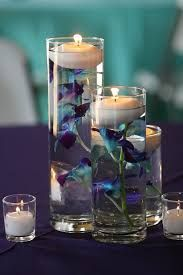 Image result for wedding centrepieces - candle vases