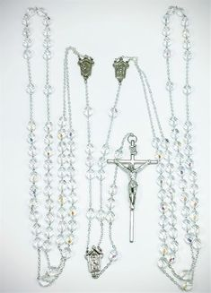Silver Tint Wedding Rosary. Two rosaries are shared in one demonstrating the union of two spirits united in marriage. 8mm Aurora Borealis Bead with Deluxe Crucifix. Immortalize your union before the Lord with our special Wedding Rosary. This item combines two rosaries, representing a symbolic linking of two spirits united in marriage. With aurora borealis rosary beads and a deluxe crucifix, it is an elegant and timeless way of celebrating the sacred Catholic sacrament.