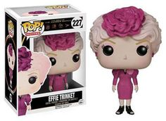 She's the escort for the district 12 tributes and now she's a Pop! vinyl figure! This Hunger Games Movie Effie Trinket Pop! Vinyl Figure features the character from the hit series of films wearing her gaudy pink dress. Figure measures approximately 3 3/4-inches tall and comes packaged in a window display box.