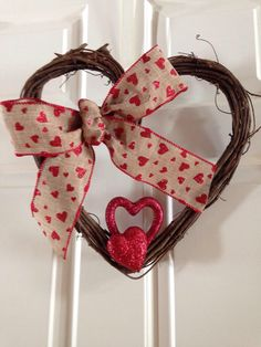 Heart wreath with burlap bow by CreationsDSK on Etsy https://www.etsy.com/listing/220582271/heart-wreath-with-burlap-bow