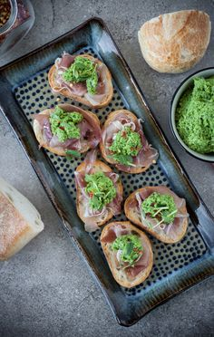 A pesto made with fresh spring peas is the perfect accompaniment to prosciutto crostini.