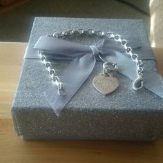 Tiffany&co sterling silver Braclet w/Charm Tiffany&co sterling silver 925 7 IN Braclet with Return to Tiffany Heart Tag Charm w/Tiffany Jump Ring Tiffany & Co. Jewelry Bracelets