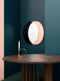 Bower's booth at this year's ICFF in New York included mirrors designed to look three-dimensional and minimal black lamps with ball-shaped bulbs.