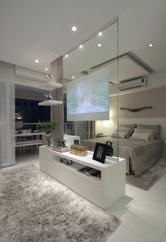 Modern contemporary luxury white master bedroom with TV inside a glass panel ! Sexy, cool and wonderful! Double bedroom dream house luxury home house rooms bedroom furniture home bathroom home modern homes interior penthouse House Design, House, Home, Bedroom Design, Luxurious Bedrooms, Tv In Bedroom, House Interior, Home Interior Design, Dream Rooms