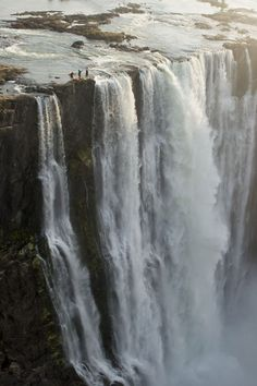South Africans Steve Fisher and Dale Jardine and American Sam Drevo paddled up to the lip of the mile-wide Victoria Falls - the largest wate...