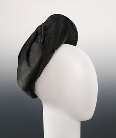 Hat (1950): a hat that looks like hair--illustrates the enduring Surrealist tendencies.