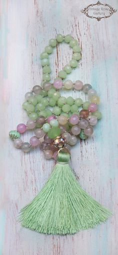 Green Silk Tassel Necklace, Spring Gemstones Necklace, Pastel Colourful Boho Chic Necklace, Gift for her A Unique , beautiful, Pastel Hand knotted , Long Tassel Necklace . Features antique rhinestones, beautiful pastel agate faceted gemstones 8mm , Czech glass , crystal beads ,