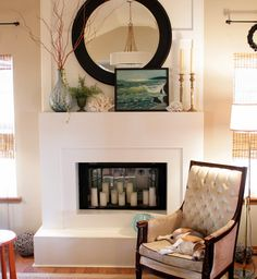 Nice layering, scale and balance on the mantle.  Love the chubby beagle in the chair!